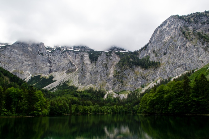 Grey mountains and clouds at the Hinterer Langbathsee
